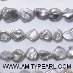 3112 light grey keshi pearl 8x11mm.jpg