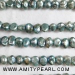 3180 keshi pearl 7mm green.jpg
